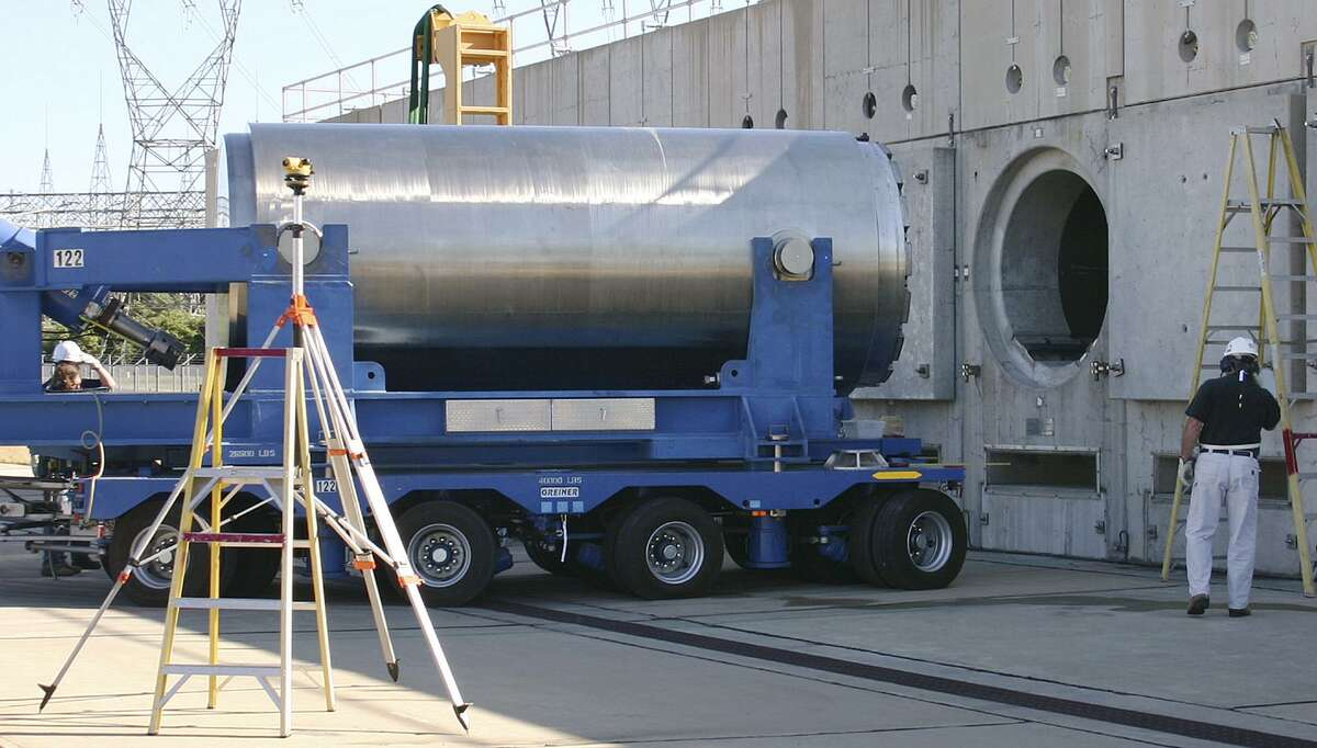 In this June 15, 2012 photo released by Dominion Resources, a spent fuel storage container is offloaded from a trailer into a horizontal storage module at the Millstone Power Station in Waterford, Conn. With the collapse of a proposal for nuclear waste storage at Nevada's Yucca Mountain, Millstone and other plants across the country are building or expanding on-site storage for waste.(AP Photo/Dominion Resources)