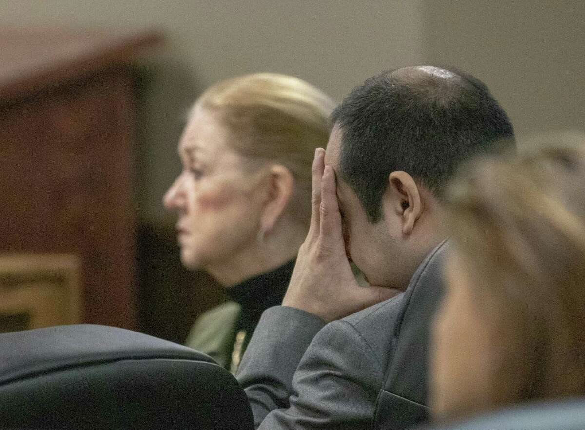 Rafael Leos-Trejo buries his face in his hand as his wife's 12-year-old daughter delivers a victim impact statement Thursday, Jan. 31, 2019 in the 435th state District Court Judge Patty Maginnis at the Lee G. Alworth Building in Conroe. Leos-Trejo was sentenced to life in prison for the murder of his wife.