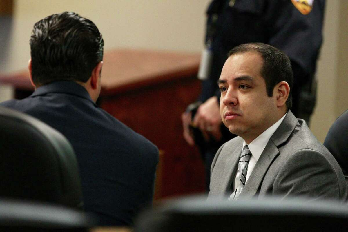 Rafael Leos-Trejo, right, speaks with his defense attorney Joe Ray Rodriguezduring his murder trial in the 435th state District Court Judge Patty Maginnis at the Lee G. Alworth Building, Thursday, Jan. 31, 2019, in Conroe. Trejo, of Spring, is charged with shooting and killing his wife Jessica Torres Leos.