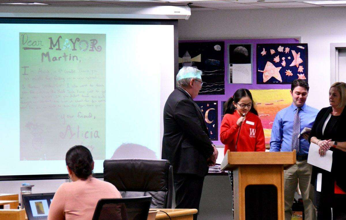Alicia, a fourth grader from Westover Magnet Elementary School, reads a thank you note to Mayor David Martin at a Board of Education meeting in Stamford, Conn. on Jan. 29, 2019. Westover students presented at the meeting to thank public officials for placing them in a new school building after their old one closed due to mold infestation.