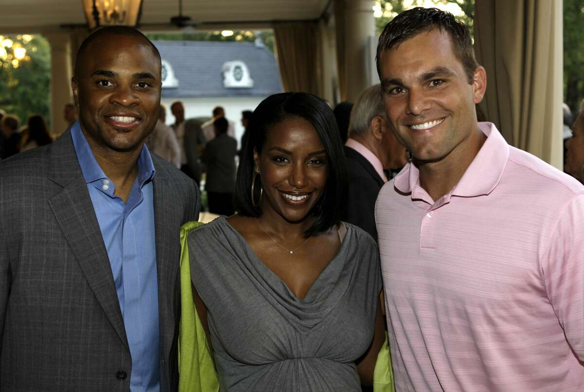 Houston Texans general manager, Rick Smith, his wife, Tiffany Smith and Texans kicker Kris Brown at the home of Tilman Fertitta for the annual Houston Children's Charity evening Thursday, May 7, 2009, in Houston. ( Melissa Phillip / Chronicle ) For Shelby Hodge Story
