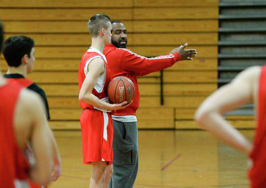 Lumberton's assistance coach Tigee Rideaux helps Brock McClure during the team's practice in their gym on Thursday. Photo taken on Thursday, 01/31/19. Ryan Welch/The Enterprise Photo: Ryan Welch, The Enterprise / ©Ryan Welch