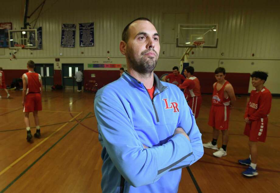Lumberton's head coach Josh Mitchell poses for a photo as the boys basketball team practices in their gym on Thursday.