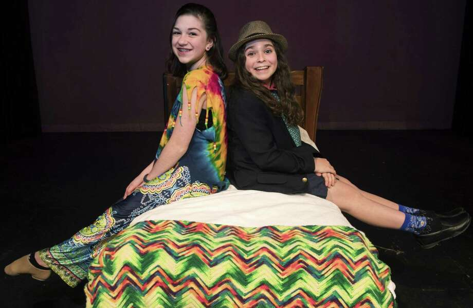 Two Norwalk 11-year-olds, Katie Romano and Laszlo Balazs, at the Crystal Theatre Thursday, January 31, 2019, in Norwalk, Conn. Balazs and Romano wrote the music and lyrics and for their new play, Growth Spurt, that will be performed Saturday at Crystal Theatre. They started writing the play three years ago, when both were in 3rd grade. Photo: Erik Trautmann / Hearst Connecticut Media / Norwalk Hour