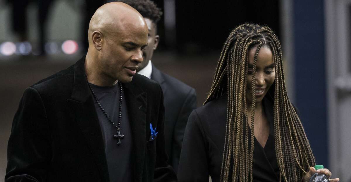 Former Houston Texans general manager Rick Smith and his wife Tiffany arrive to a public celebration of life for Houston Texans owner Robert C. McNair at NRG Stadium, Friday, Dec. 7, 2018, in Houston. McNair, who brought the NFL back to Houston after the Oilers left for Tennessee, died on Nov. 23 at the age of 81.