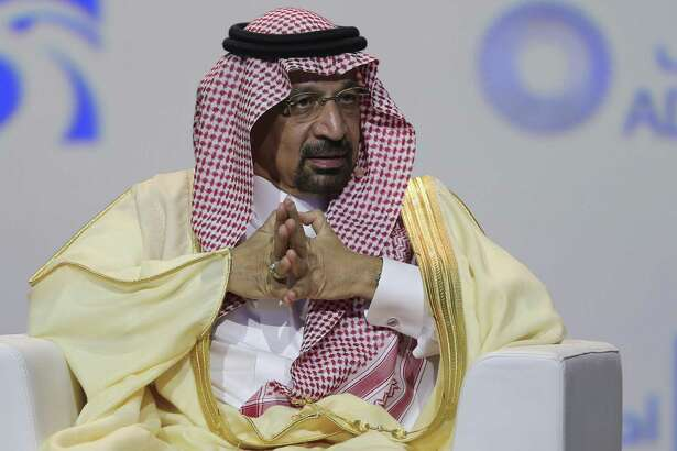 "FILE - In this Nov.12, 2018 file photo, Khalid Al-Falih, Saudi Energy and Oil Minister, speaks at the Abu Dhabi International Exhibition & Conference, in Abu Dhabi, United Arab Emirates. Al-Falih said Sunday, Jan. 13, 2019, at the Atlantic Council's Global Energy Forum in Abu Dhabi that he's not happy with the ""range of volatility"" seen over the past two to three years. Cautious not to set a price target or range for oil, he explained there are consequences when energy prices dip too low or rise too high. (AP Photo/Kamran Jebreili, File)"