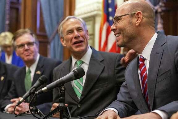From right, Speaker of the House Dennis Bonnen, Gov. Greg Abbott and Lt. Gov. Dan Patrick announce a tax reform plan at the State Capitol in Austin, Wednesday, Jan. 31, 2019.(Stephen Spillman / for Express-News)