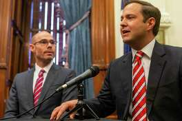 Texas House Speaker Dennis Bonnen, R-Angleton, and state Rep. Dustin Burrows, R-Lubbock, are entangled in a war of words with rightwing gadfly Michael Quinn Sullivan of Empower Texans. They are shown here at the State Capitol in Austin on Jan. 31, 2019.