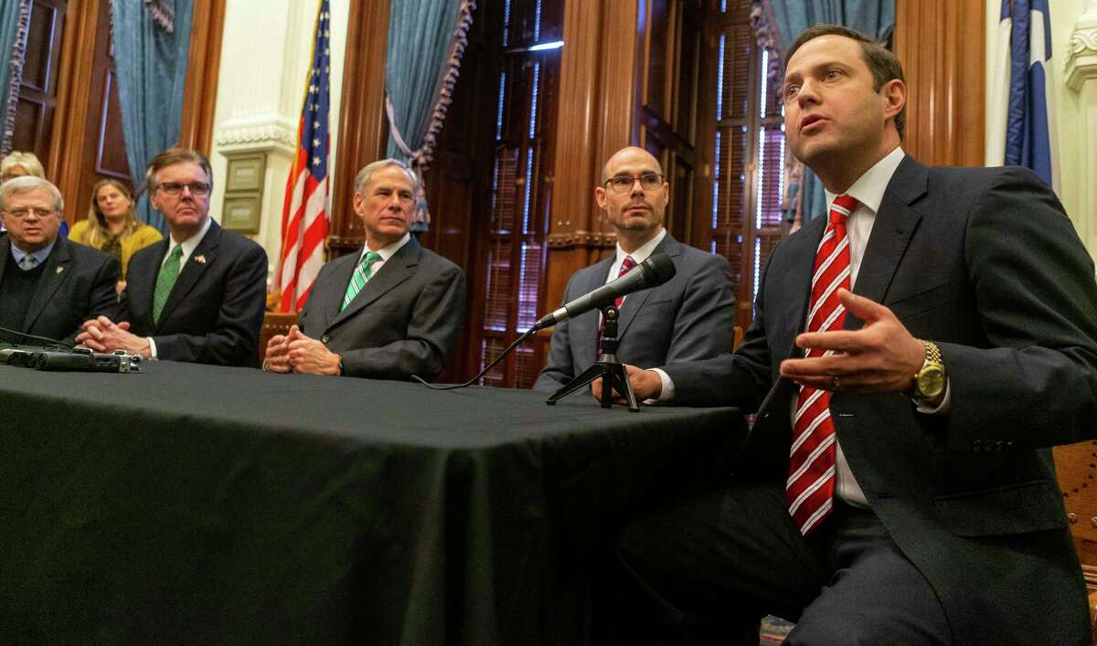 State Sen. Paul Bettencourt, R-Houston, Lt. Gov. Dan Patrick, Gov. Greg Abbott, Speaker of the House Dennis Bonnen and State Rep. Dustin Burrows, R-Lubbock, announce a tax reform plan at the State Capitol in Austin, Wednesday, Jan. 31, 2019.(Stephen Spillman / for Express-News)