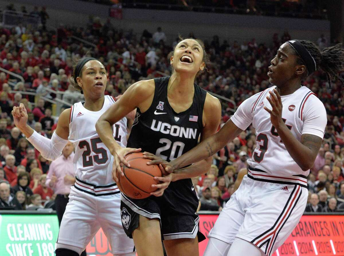 Connecticut forward Olivia Nelson-Ododa (20) looks to shoot as Louisville guards Jazmine Jones (23) and Asia Durr (25) defend during the first half of an NCAA college basketball game in Louisville, Ky., Thursday, Jan. 31, 2019. (AP Photo/Timothy D. Easley)