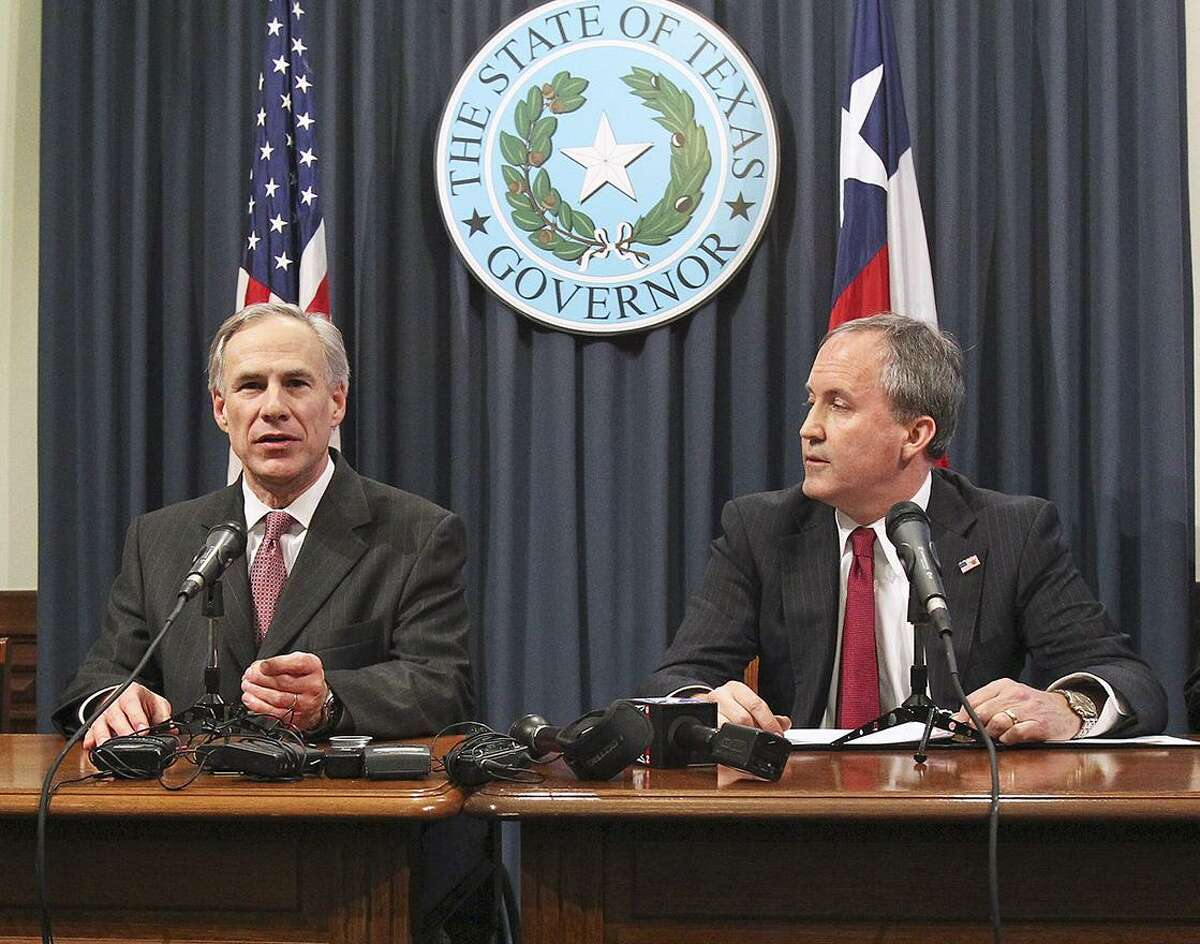 Governor Greg Abbott is joined by Attorney General Ken Paxton at a press conference in February, 2015.