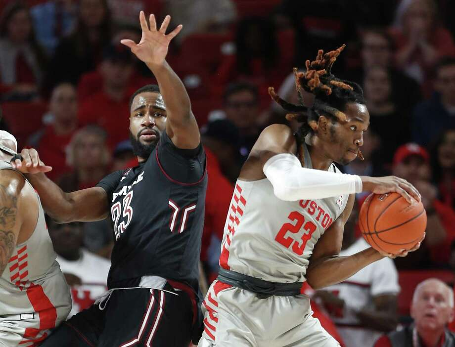 Houston forward Cedrick Alley Jr. (23) pulls a rebound from Temple center Damion Moore (23) during the first half on a NCAA basketball game at Fertitta Center on Thursday, Jan. 31, 2019, in Houston. Photo: Brett Coomer, Houston Chronicle / Staff Photographer / © 2019 Houston Chronicle