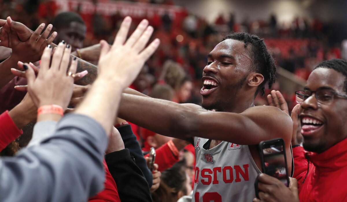 Houston guard Dejon Jarreau (13) celebrates the Cougars's 73-66 win over Temple with the fans in the student section in an NCAA basketball game at Fertitta Center on Thursday, Jan. 31, 2019, in Houston.