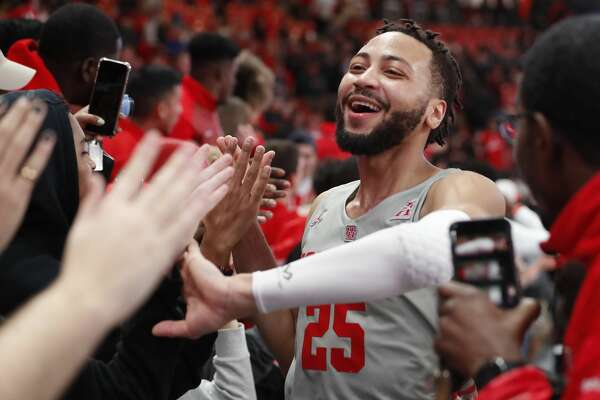 Houston guard Galen Robinson Jr. (25) celebrates the Cougars's 73-66 win over Temple with the fans in the student section in an NCAA basketball game at Fertitta Center on Thursday, Jan. 31, 2019, in Houston.