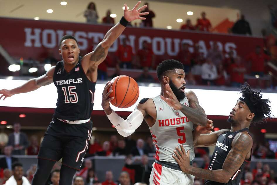 Houston guard Corey Davis Jr. (5) looks to pass between Temple guard Nate Pierre-Louis (15) and guard Quinton Rose (1) during the second half of an NCAA basketball game at Fertitta Center on Thursday, Jan. 31, 2019, in Houston.