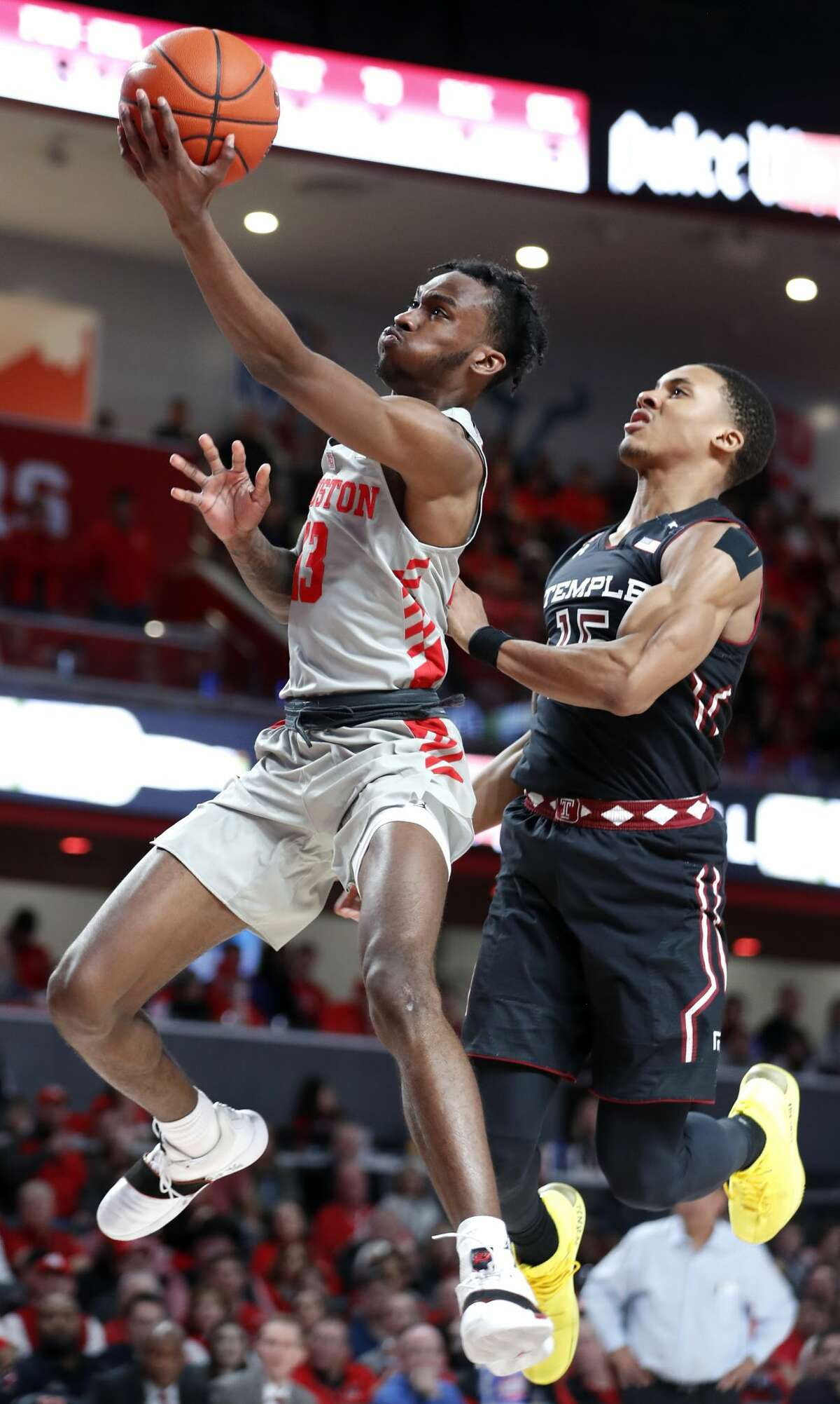 Houston guard Dejon Jarreau (13) drives past Temple guard Nate Pierre-Louis (15) for a layup during the second half of an NCAA basketball game at Fertitta Center on Thursday, Jan. 31, 2019, in Houston.