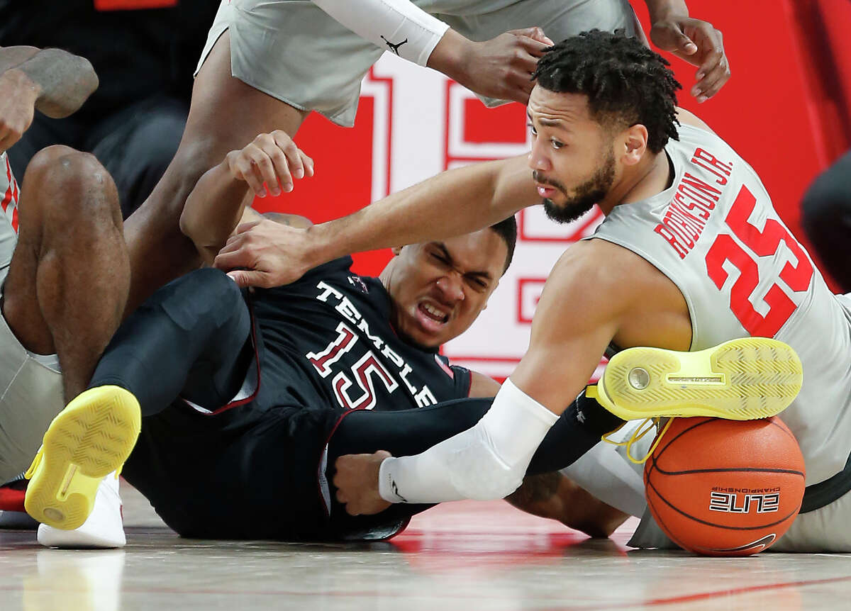 Houston guard Galen Robinson Jr. (25) goes to the floor after a loose ball with Temple guard Nate Pierre-Louis (15) during the second half on a NCAA basketball game at Fertitta Center on Thursday, Jan. 31, 2019, in Houston. The play ended up in a jump ball, with the possession going to Houston.