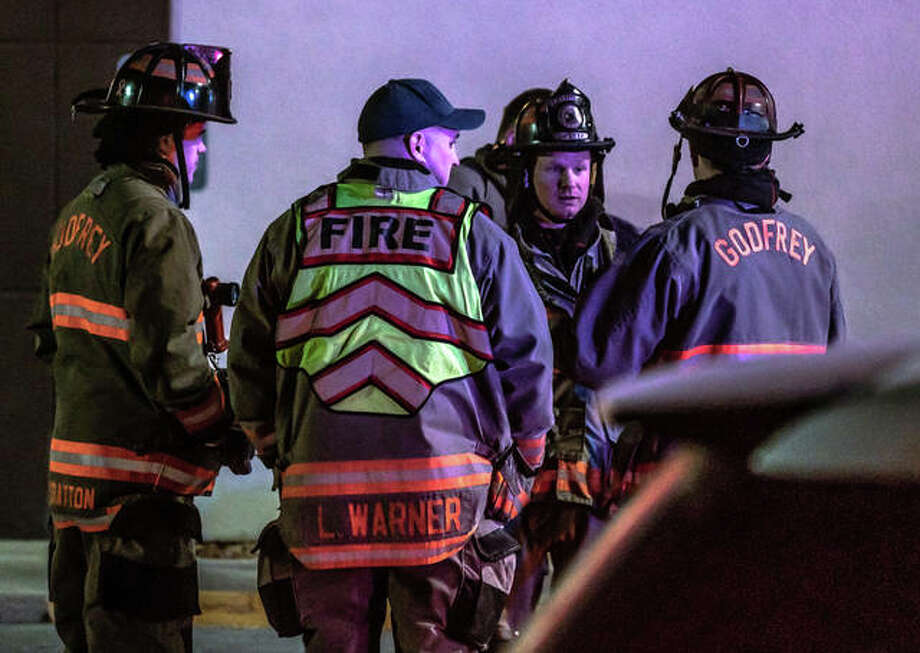 Godfrey firefighters convene Thursday night outside of Arby's on Godfrey Road where a motorist struck a natural gas line, before leaving the scene.