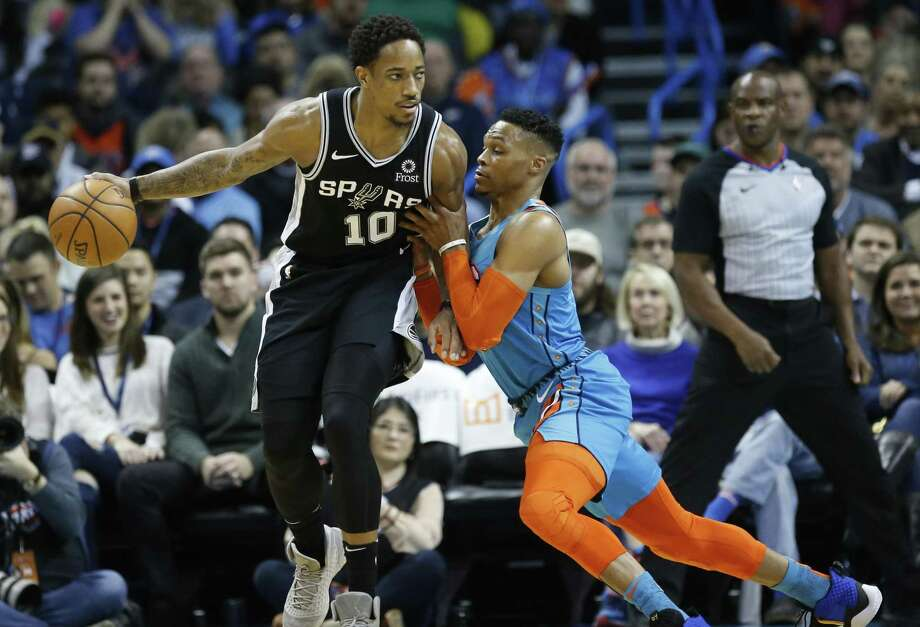 San Antonio Spurs guard DeMar DeRozan (10) drives against Oklahoma City Thunder guard Russell Westbrook, right, during an NBA basketball game between the San Antonio Spurs and the Oklahoma City Thunder in Oklahoma City, Saturday, Jan. 12, 2019. (AP Photo/Sue Ogrocki) Photo: Sue Ogrocki, STF / Associated Press / Copyright 2019 The Associated Press. All rights reserved.