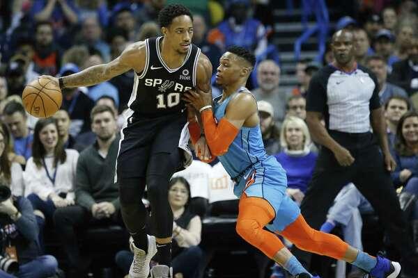 San Antonio Spurs guard DeMar DeRozan (10) drives against Oklahoma City Thunder guard Russell Westbrook, right, during an NBA basketball game between the San Antonio Spurs and the Oklahoma City Thunder in Oklahoma City, Saturday, Jan. 12, 2019. (AP Photo/Sue Ogrocki)
