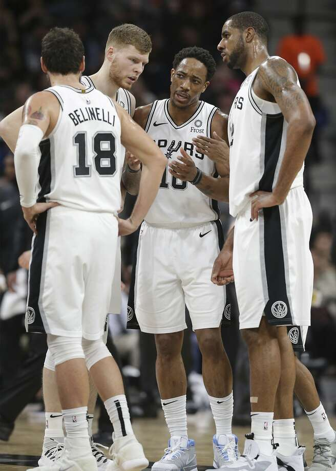 DeMar DeRozan calls a conference on the floor with teammates as the Spurs host the Nets at the AT&T Center on January 31, 2019. Photo: Tom Reel, Staff Photographer