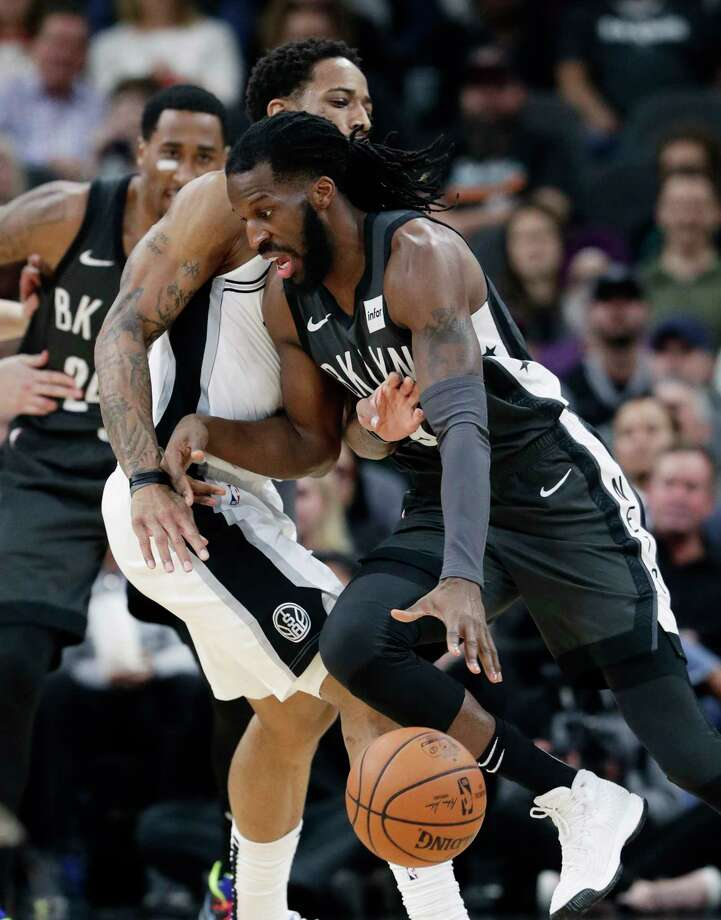 Brooklyn Nets forward DeMarre Carroll (9) drives around San Antonio Spurs guard DeMar DeRozan (10) during the first half of an NBA basketball game in San Antonio, Thursday, Jan. 31, 2019. (AP Photo/Eric Gay) Photo: Eric Gay, Associated Press / Copyright 2019 The Associated Press. All rights reserved.