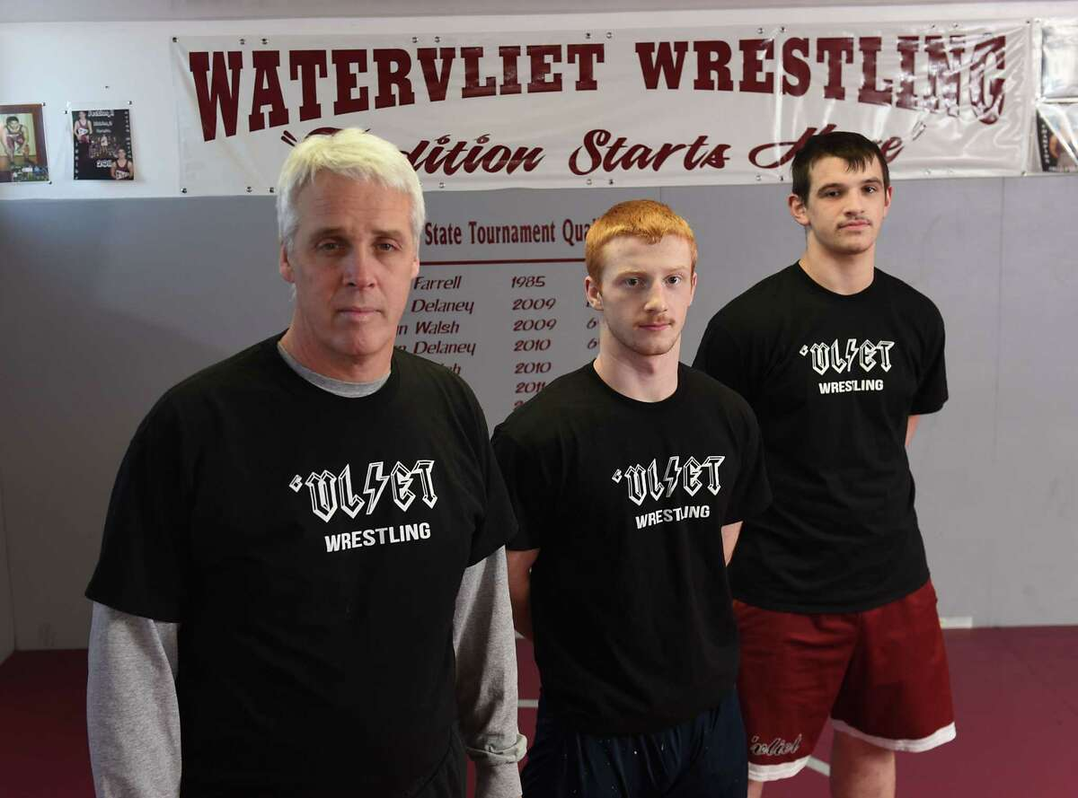 Watervliet wrestling coach Dennis Lane and seniors Owen Lyons, center, and Sterling Spoon at practice on Thursday, Jan. 31, 2019 in Watervliet, N.Y. (Lori Van Buren/Times Union)