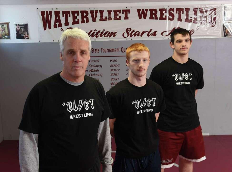 Watervliet wrestling coach Dennis Lane and seniors Owen Lyons, center, and Sterling Spoon at practice on Thursday, Jan. 31, 2019 in Watervliet, N.Y. (Lori Van Buren/Times Union)