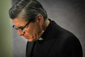 Archbishop Gustavo Garcia-Siller fights back emotions as he reads a statement about the report on priests accused of sexual abuse of minors since 1947, on Thursday, Jan. 31, 2019.