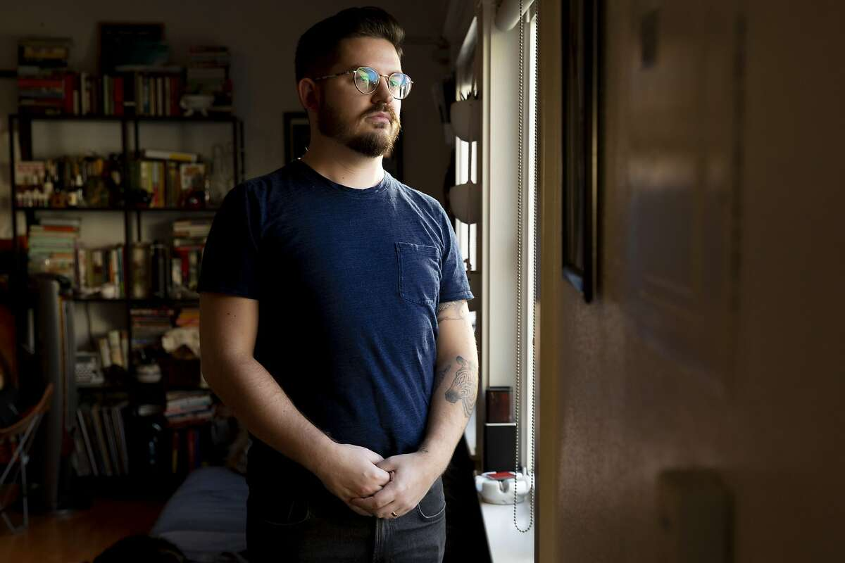 """A portrait of Zander Brandt on Wednesday, Jan. 30, 2019, in San Francisco, Calif. Last November, Brandt went to S.F. General hospital with major pain on the side of his stomach. He needed an appendectomy, but minutes before surgery hospital staff told him they were """"out-of-network"""" for his surgery and he'd wind up with a big bill if he went through with it. All other ERs in the city were full so he got the surgery there and now owes $97,000."""
