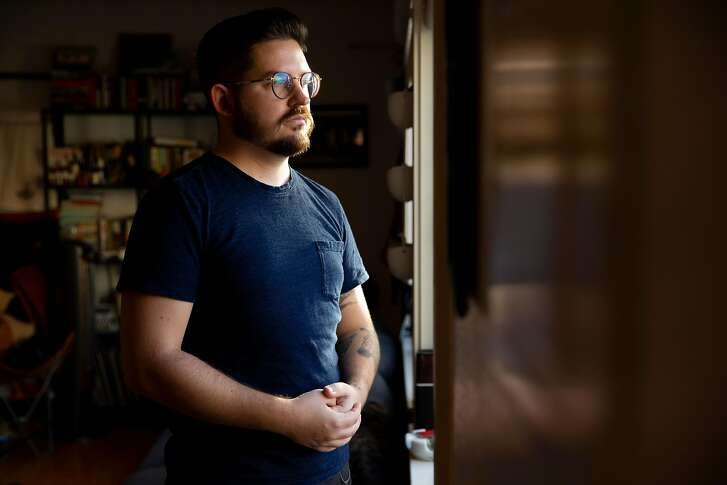 Zander Brandt, shown at his home in the Mission District, learned that all he would owe from the $92,470 in charges from San Francisco General Hospital is a $250 co-pay.