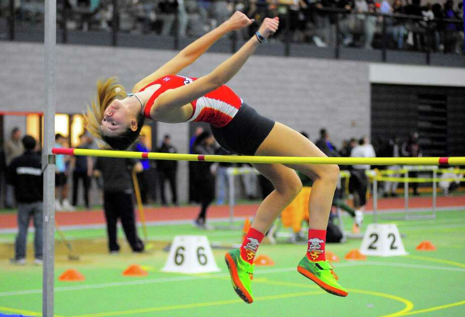 Greenwich's McCallum Harkins competes in the high jump during FCIAC Track Championship action in New Haven, Conn., on Thursday Jan. 31, 2019. Photo: Christian Abraham / Hearst Connecticut Media / Connecticut Post
