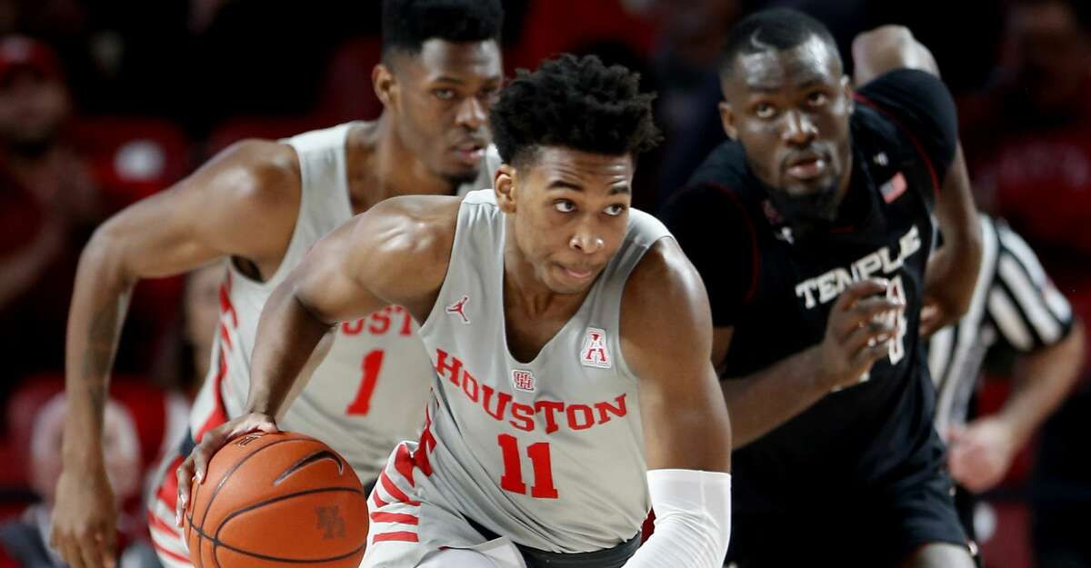 Houston guard Nate Hinton (11) takes the ball up the court against Temple during the first half on a NCAA basketball game at Fertitta Center on Thursday, Jan. 31, 2019, in Houston.