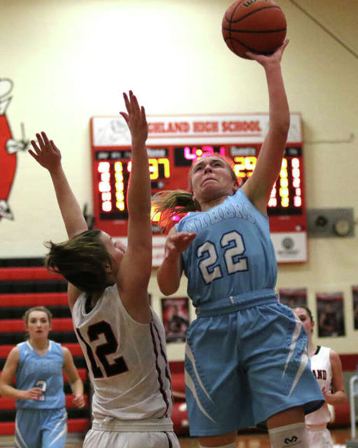 Jersey's Clare Breden (22) scores two of her game-high 17 points over Highland's Mae Riffel during the second half Thursday night at Highland High School. Photo: Greg Shashack / The Telegraph