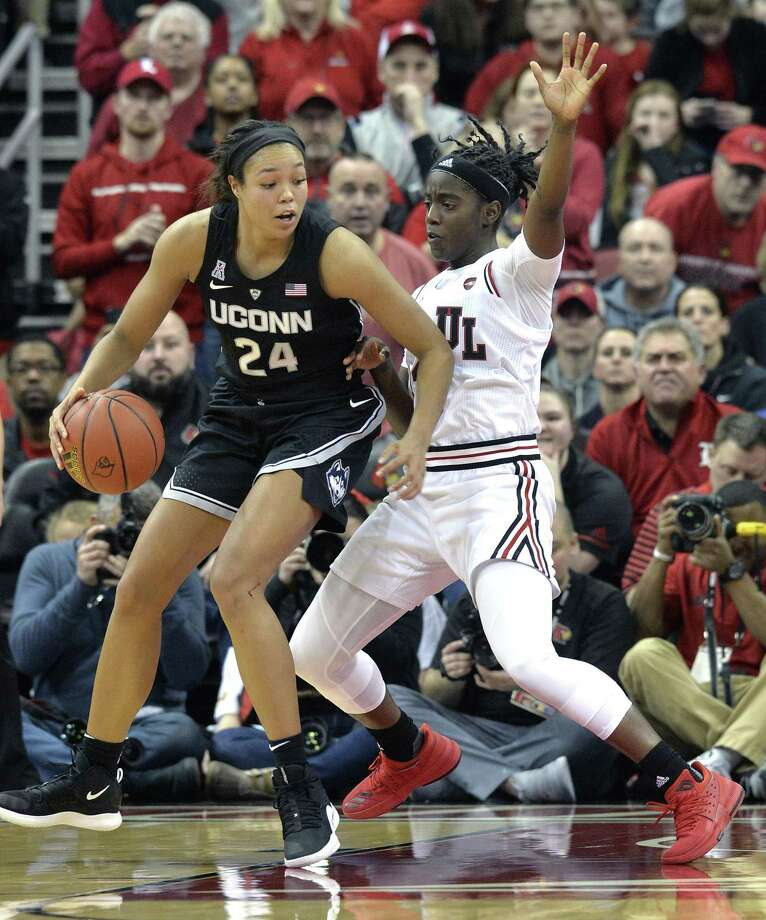 UConn's Napheesa Collier (24) attempts to get position on Louisville guard Jazmine Jones on Thursday. Photo: Timothy D. Easley / Associated Press / Copyright 2019 The Associated Press. All rights reserved