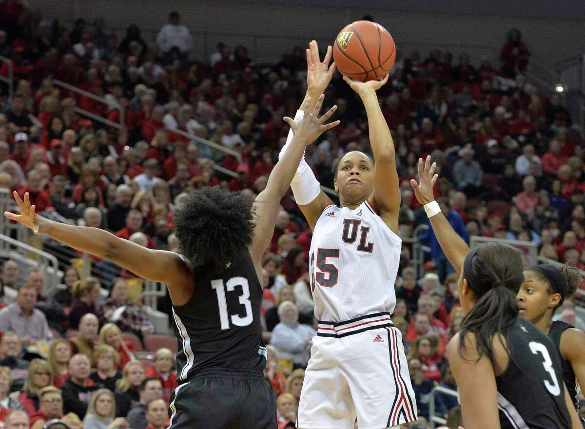 Louisville guard Asia Durr (25) shoots over Connecticut guard Christyn Williams (13) during the second half of an NCAA college basketball game in Louisville, Ky., Thursday, Jan. 31, 2019. Louisville won 78-69. (AP Photo/Timothy D. Easley)