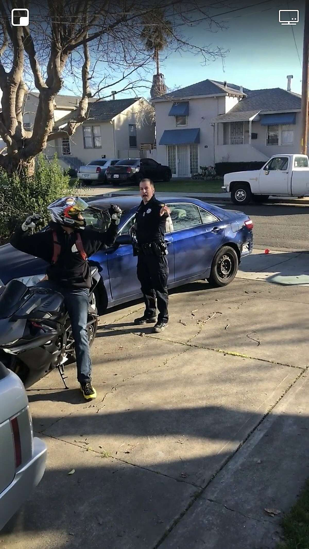 """Adrian Burrell, 28, said he got a concussion when he says he was unjustly detained by a Vallejo police officer on Tuesday, Jan. 22, 2019. A screenshot from a cell phone video taken by Burrell during the incident shows an officer wearing a nameplate reading, """"D. McLaughlin."""" Officer David McLaughlin was introduced as a new hire to the Vallejo Police Department in May 2014, according to a Vallejo City Manager's report."""