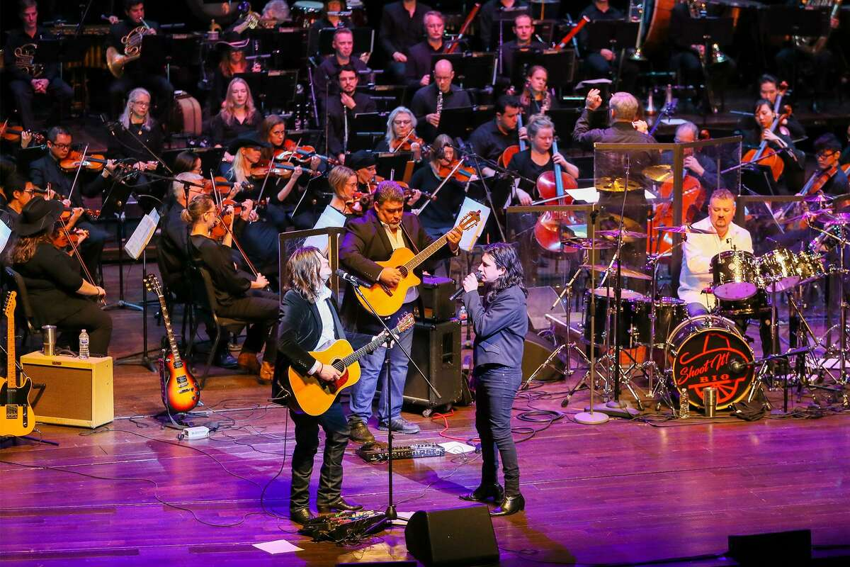 Emilio Navaira's sons, Emilio Navaira IV (front left) and Diego Navaira (front right) play with Grupo Rio, backed by the San Antonio Symphony during the symphony's Emilio tribute concert at Toin Center for the Performing Arts on Thursday, Jan.31, 2019.