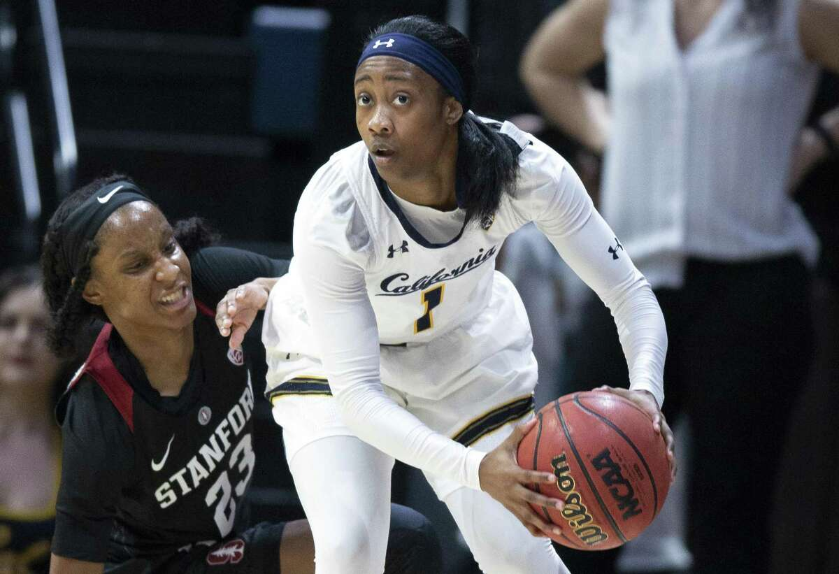 California guard Asha Thomas (1) looks to pass away from pressure by Stanford guard Kiana Williams (23) during the first quarter of an NCAA women's basketball game on Thursday, Jan. 31, 2019 in Berkeley, Calif.
