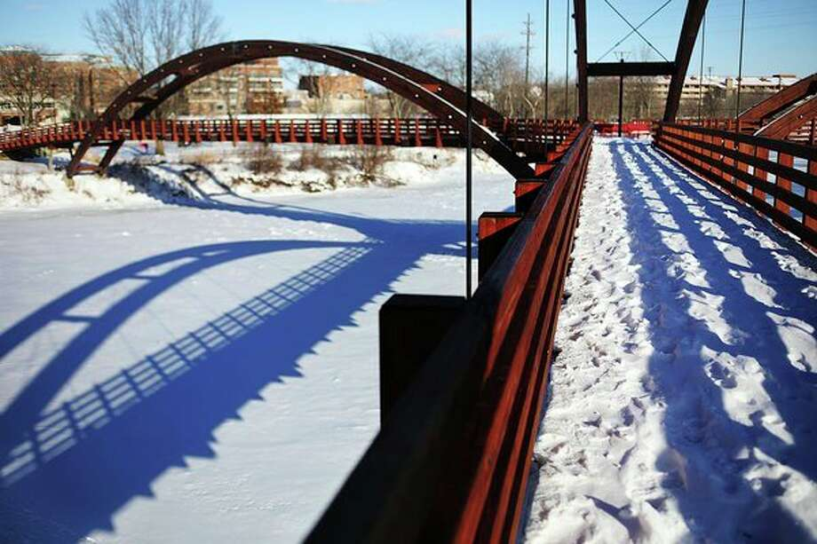 Snow covers the Tridge on Thursday afternoon in downtown Midland. For more photos, go to www.ourmidland.com. (Katy Kildee/kkildee@mdn.net)