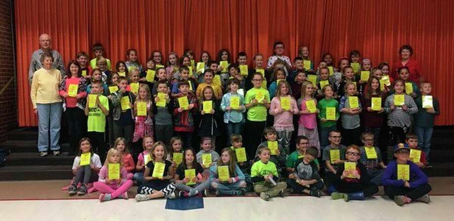 Studley Grange members present dictionaries to the third graders at Pine River Elementary School. (Photo provided)