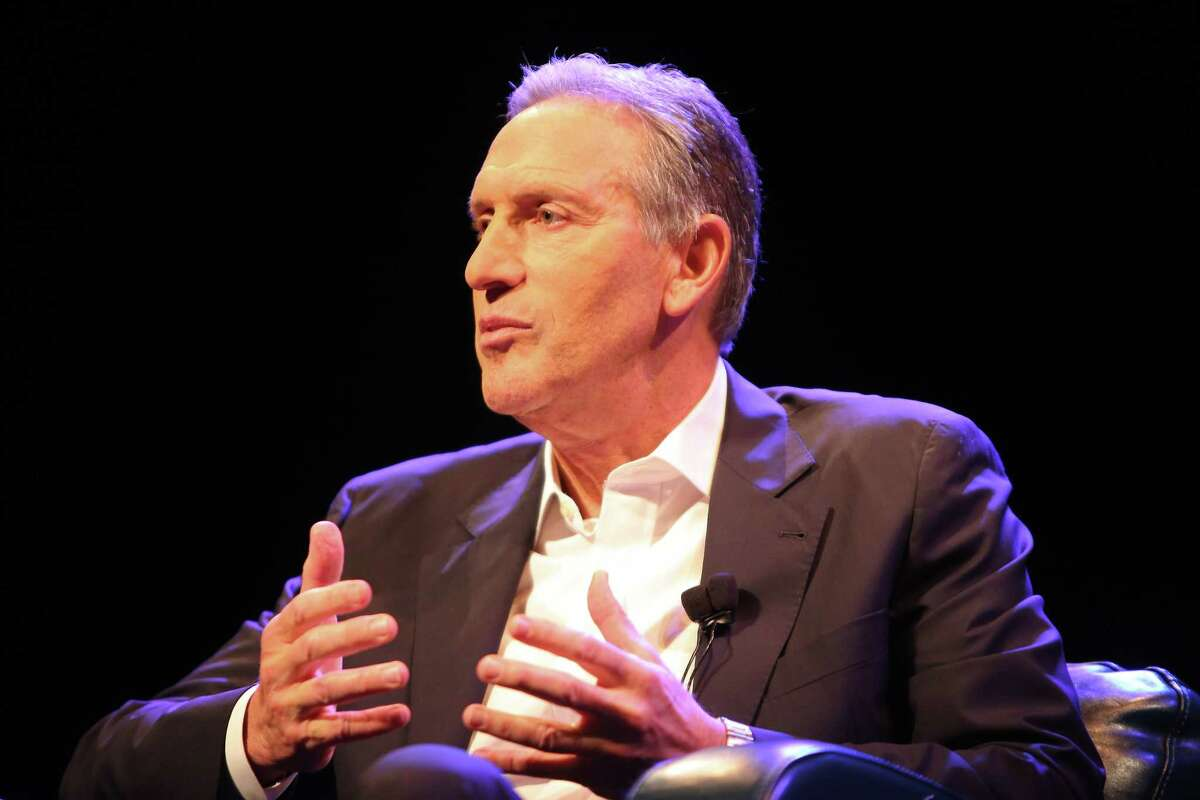 Former Starbucks CEO Howard Schultz speaks with moderator Monica Guzman, of the Evergrey,at a Town Hall about his new book,