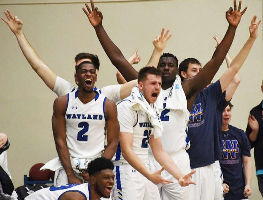 The Wayland Baptist bench which includes (l-r) Trevonta Robertson, CJ Obinwa, Rokas Mazionis, Tom Crutchley and Dax Allen celebrate a 3-point basket during the Pioneers' Sooner Athletic Conference game against Langston on Thursday at Hutcherson Center in Plainview. Photo: Claudia Lusk/Wayland Baptist University