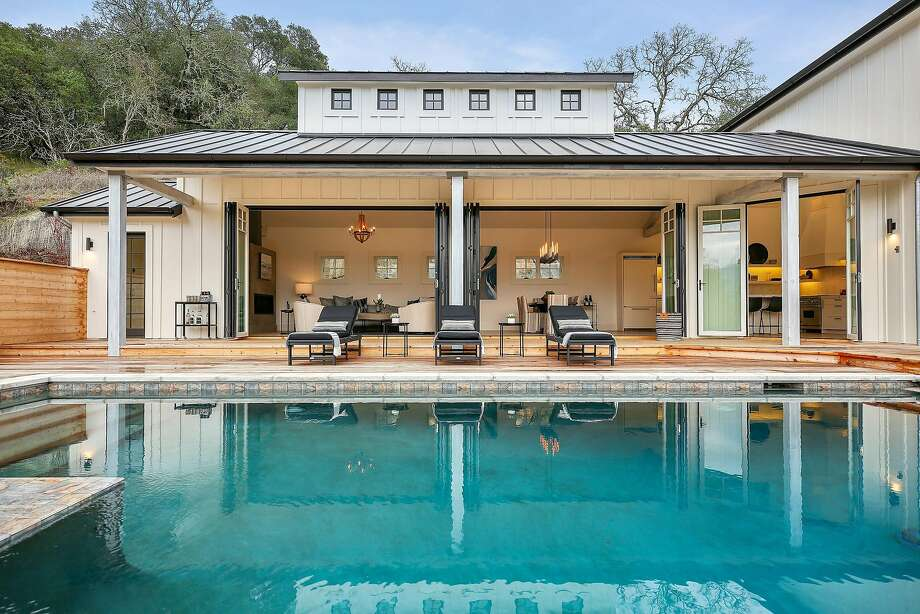 Mary Cronin of Emeryville's the Design Shop helped stage and conceptualize this contemporary farmhouse in Sonoma that includes a pool and deck access off all four bedrooms. The custom-built farmhouse is set on more than an acre. Photo: Open Homes Photography