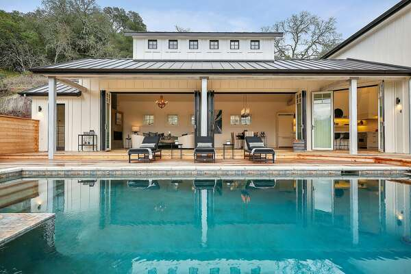 Mary Cronin of Emeryville's the Design Shop helped craft this contemporary farmhouse in Sonoma that includes a pool and deck accessoff all four bedrooms.