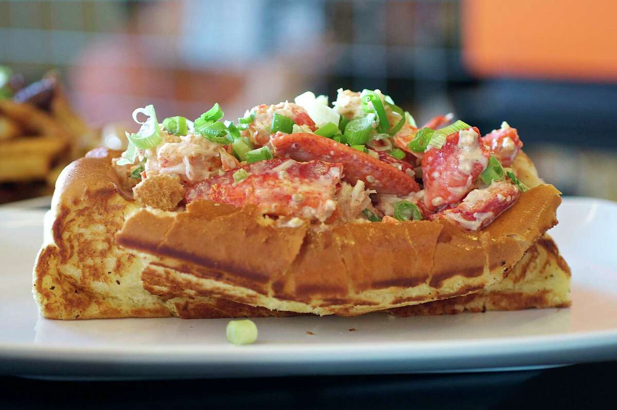 Maine-style lobster roll at Bernie's Burger Bus: Lobster tossed with house mayonnaise flavored with garlic, lemon, minced onion and celery in a toasted top-loaded bun.