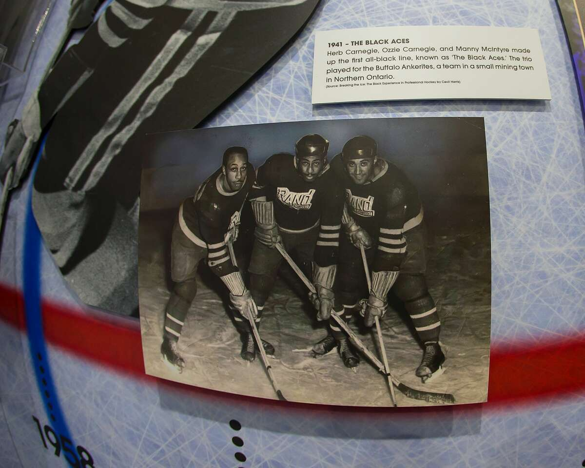 """MADISON HEIGHTS, MI - JANUARY 29: The """"Black Aces"""" picture and story on display in the NHL American Legacy Black Hockey History Tour Museum trailer at MRA Corporate Headquarters on January 29, 2019 in Madison Heights, Michigan. (Photo by Dave Reginek/NHLI via Getty Images)"""