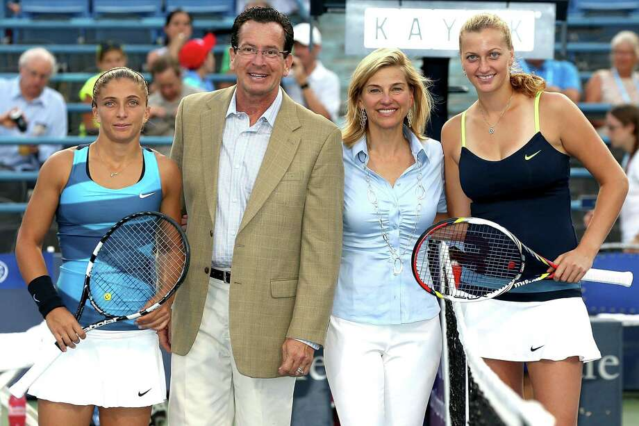 Sara Errani of Italy (L) and Petra Kvitova (R) of Cezch Republic pose at the net with Gov. Dannel P. Malloy and New Haven Open at Yale Tournament Director Anne Worcester after the coin toss during the semifinals at the Connecticut Tennis Center at Yale on August 24, 2012. Photo: Matthew Stockman / Getty Images / 2012 Getty Images