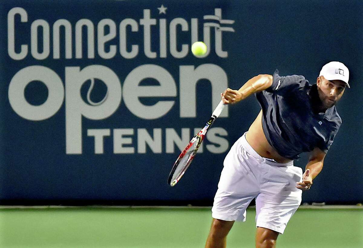 James Blake returns a shot toJohn McEnroe on Stadium Court Friday, August 24, 2018 in an Invesco Series QQQ Men's Legend championship match at the Connecticut Open at the Connecticut Tennis Center at Yale in New Haven. James Blake won, 6-4.