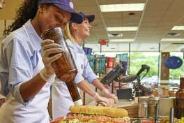 Workers make subs at a Jersey Mike's shop in Holmdel, N.J. A Jersey Mike's shop is scheduled to open in the summer of 2019 at 1259 E. Putnam Ave., in Greenwich, Conn.